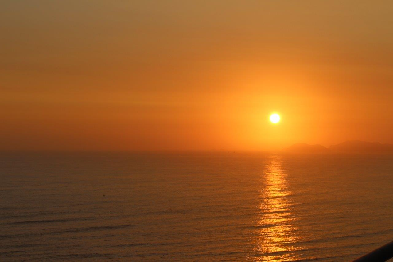Different sunsets every day from the apartment of our friends in Barranco, Lima