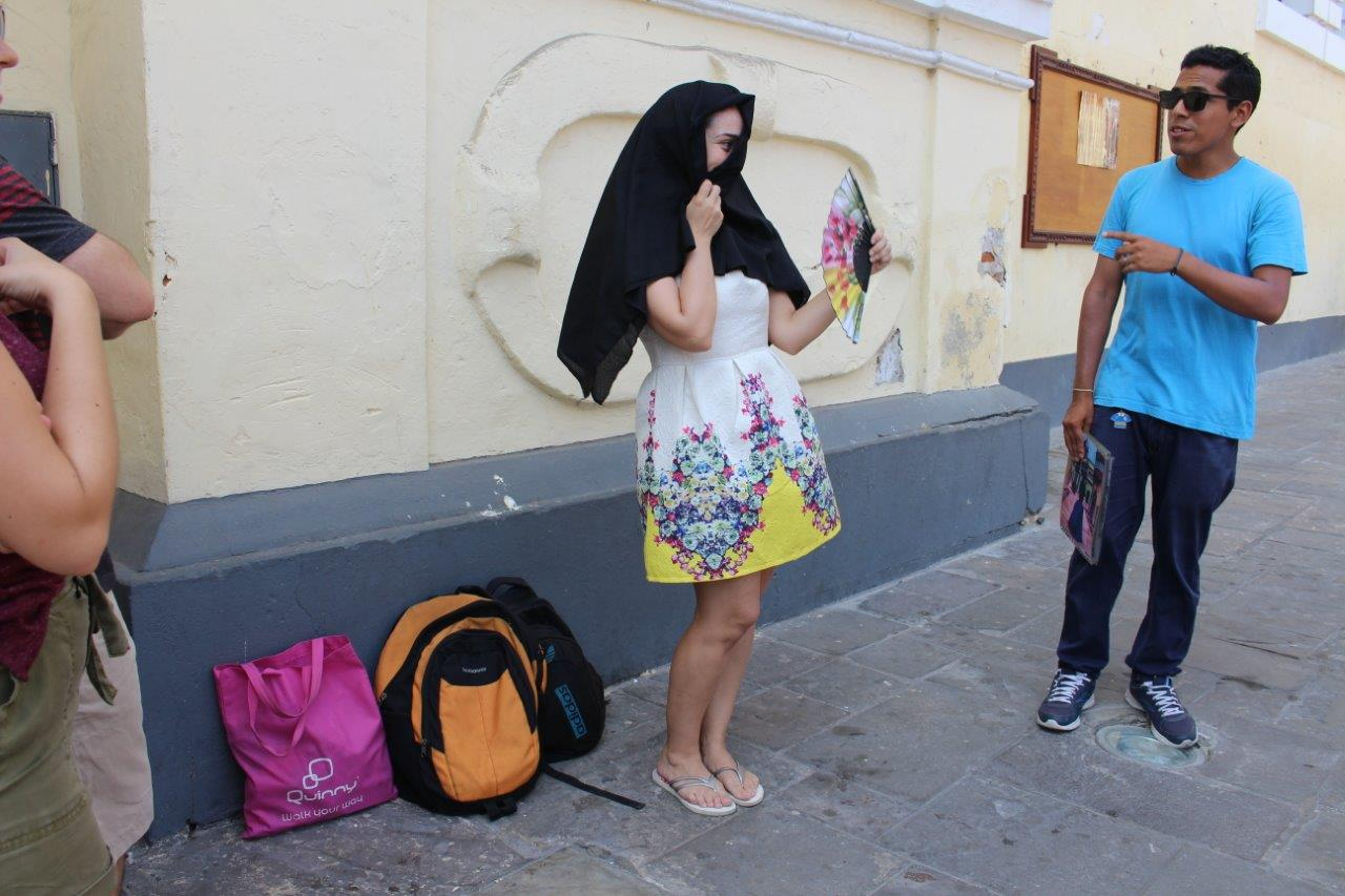 """During our city tour we """"found"""" this Limeña lady wearing the typical cover for the face"""