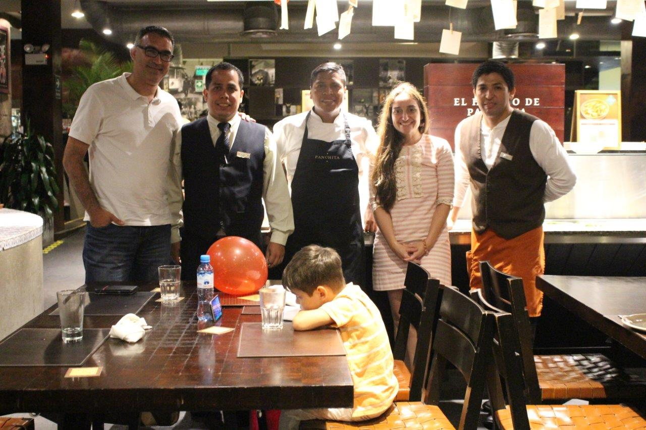 Our hosts: Walter, chef Miguel and our waiter Pepe- at Restaurante Panchita in Lima... and our son Noah