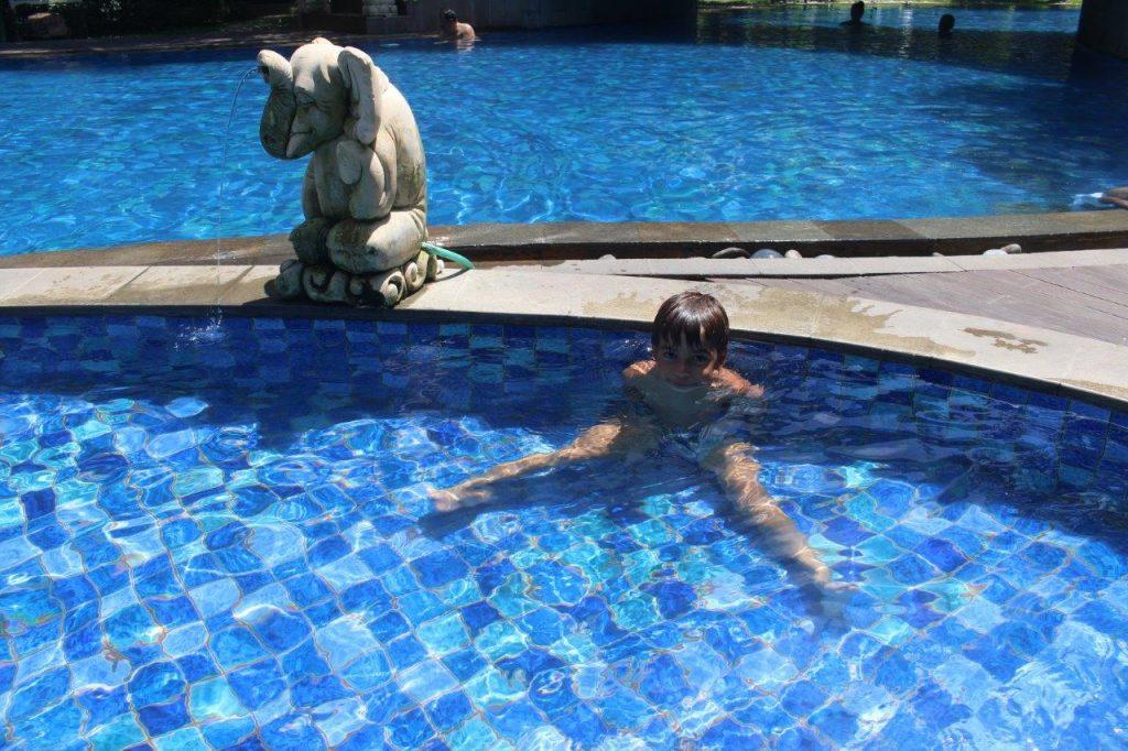 Noah enjoying the pool at the Ramada Encore Bali Seminyak