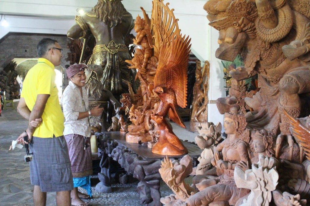 Wood carving in I Made Ada, in Bali
