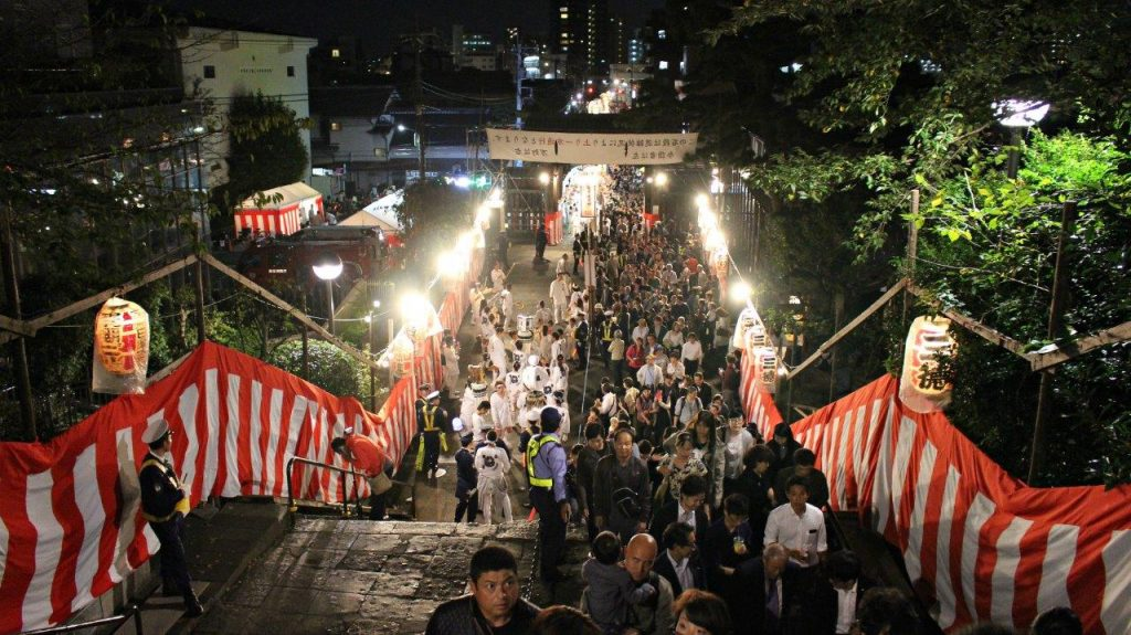 The crowd enjoying the parade of Oeshiki Festival in Tokyo