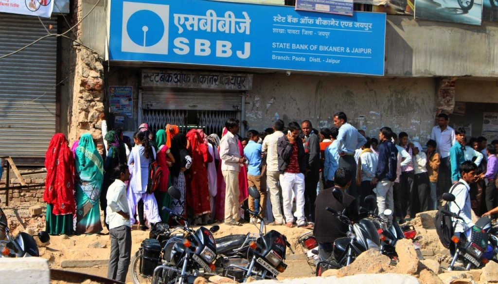 The banks are always full of people queueing to withdraw money in India