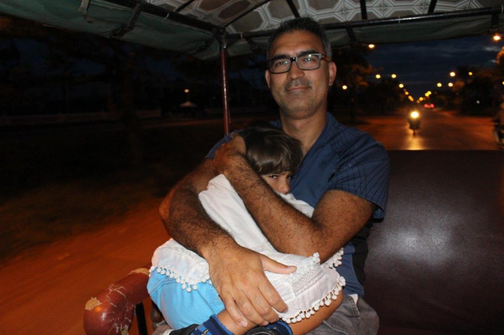 Being driven by tuk tuk to the entrance of Angkor Wat, in Siem Reap, at very early hours (5AM!!)