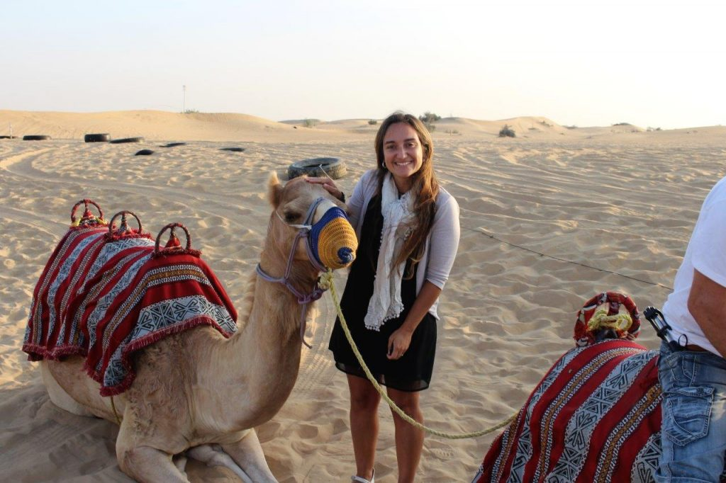 Ruth thanking her friend during the sunrise in the desert in Dubai